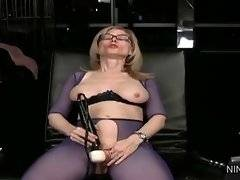 In this porn video you can see attractive Nina Hartley