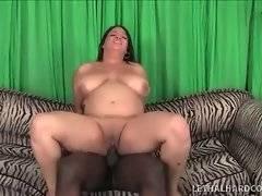 Big meloned fat chick rides thick black bone.