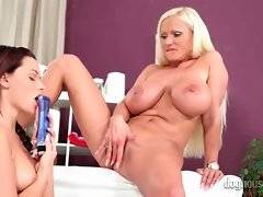 Big boobed blonde lady gets her snatch sucked by hot girl.