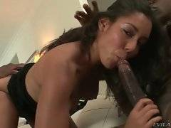 Good looking black sweetie gives blowjob to two horny men.