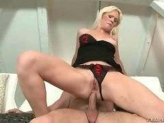 Hot looking blonde sits down on hard dick and jumps.