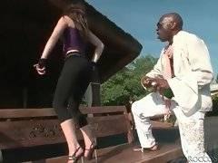 Hot slutie is dancing and undressing for black dude outdoor.