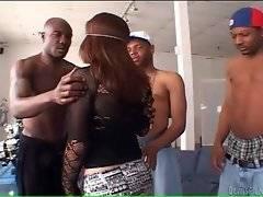 Pretty latin babe wraps her full lips around black dick.