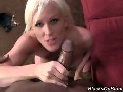 Breasted blondie gets on her knees to please black guy with oral.