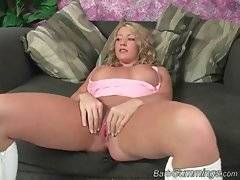 Naughty blondie demonstrates her big boobs and pink pussy.