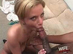 Sluty white chick Alex Divine hungrily slurps big black bone.