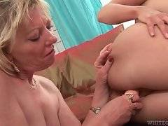 Old lesbian Jane C fucks her younger lover with dildo.
