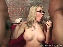 Big boobed blondie hungrily attacks two thick black cocks.