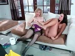 Experienced Nina Hartley doesn`t mind to have fun with young cutie.