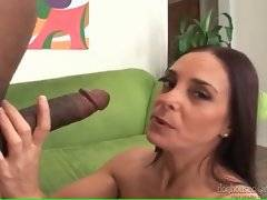 Lady shows all her charms and than starts to play her pussy.