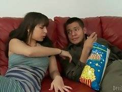 Nina Lopez helps her step brother to get out a pop corn stucking in his teeth.