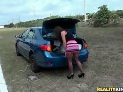 Hot looking mommy Emily Briar needs to have the wheel in her car changed.