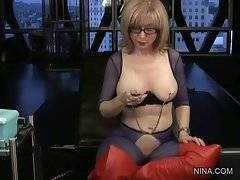 Nina Hartley demonstrates a device for nipple stimulation.