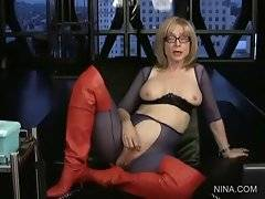 Watch Nina in red Hessian boots with her boobs and pussy flashed.