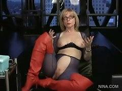 Nina puts on black rubber glove, lubes it and rubs her pussy.