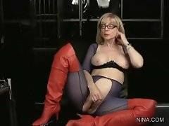 Pretty blonde milf works toy inside her pussy.
