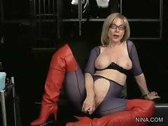 Good looking mature lesbian pleases her pussy with toy.