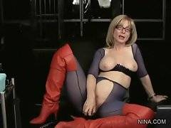 Nina makes herself turned on while answering on-line questions.
