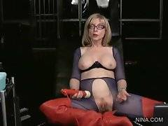 Nina skillfully works at her snatch with vibrating wand.