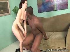 Babe holds her legs right near her head to give black dude good access to her hole.
