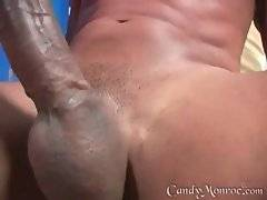 Tattooed white bitch Candy is jumping on thick black dong.