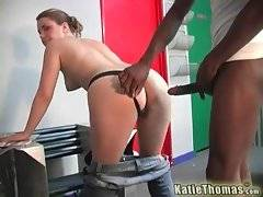 Horny black fellow undresses naughty Katie Thomas.