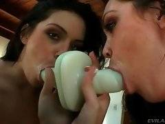 Hungry brunette loves to work her mouth at big sex toys.