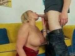 Big boobed blond lady kneels down and sucks on friend`s stiff dick.