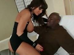 Awesome lady is tempting big black man with the view of her charms.