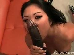 Tough black stud deeply penetrates slutty Asian chick.