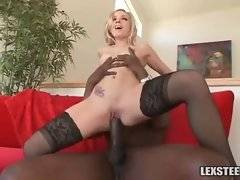 Awesome blond chick is jumping on black dude`s giant shaft.