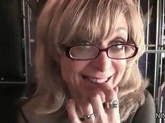 Nina Hartley has mature slut Deauxma chained hand and foot.