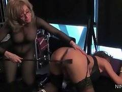 Mature blond lesbian Nina spanks her victim Deauxma making her very excited.