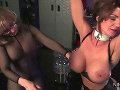 Deauxma with her hands chained above her head and her pussy planted with dildo gets spanked.