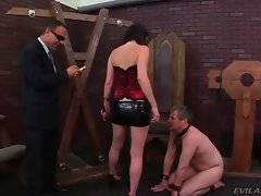 Sexy dominating brunette humiliates her poor slave on his new boss`s eyes.