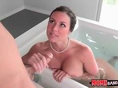 Amazing big boobed milf strokes and sucks stepson`s thick cock.