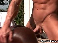 Muscled white stud plants his big cock inside ebony slut`s eager hole.
