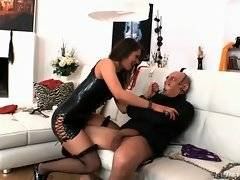Hungry mistress takes captive`s pants off and frees his fat dong.