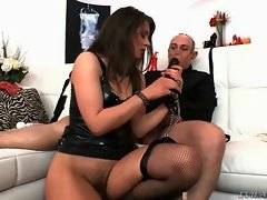 Babe is fucking herself with fake cock letting her captive watch this.