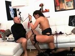 Horny mistress greatly enjoys her captive`s fat uncut cock.