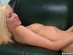 Sweetie lies down naked on black couch ready for some solo.