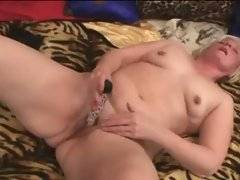 Playful aged chick does her craving pussy with sex toy.