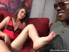 Tough black stud covers Alana Rains` sexy white feet with hot kisses.