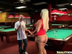 Big bottomed blond milf in little red dress plays pool with cute stud.