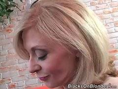 Well-known white lady Nina Hartley is ready to taste juicy black cock.