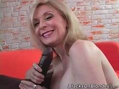 Nina Hartley knows well how to treat big erect black dick properly.