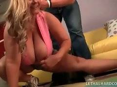 Muscled trainer shows huge boobed BBW some exercises she should do.