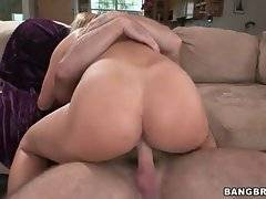 Lovely big bottomed babe is jumping on nice massive dong.