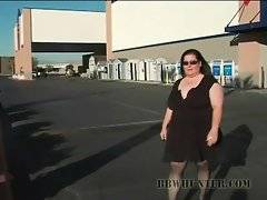 Charming black guy tries to make friends with white BBW at street.