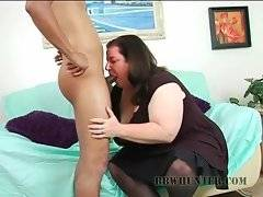 Horny obese chick hungrily attacks black guy`s big erect dong.